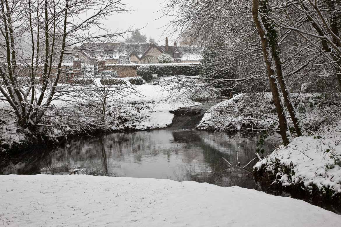 Knightstone in snow photographed from the pond in the park.