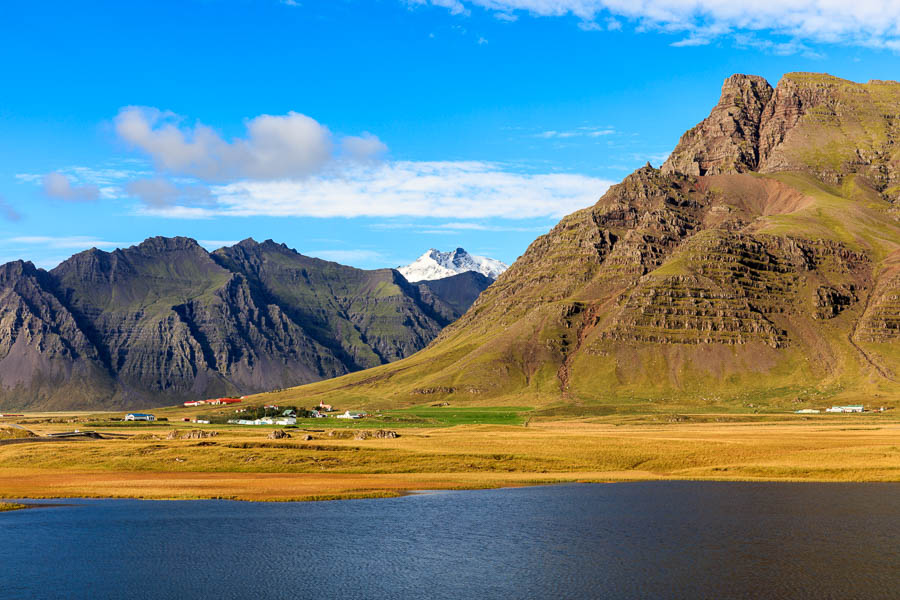 The village (west of Höfn) is dwarfed by the mountains behind