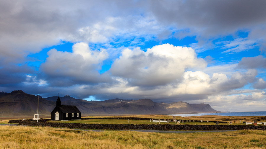 Budir church set in its environment of mountains and sea