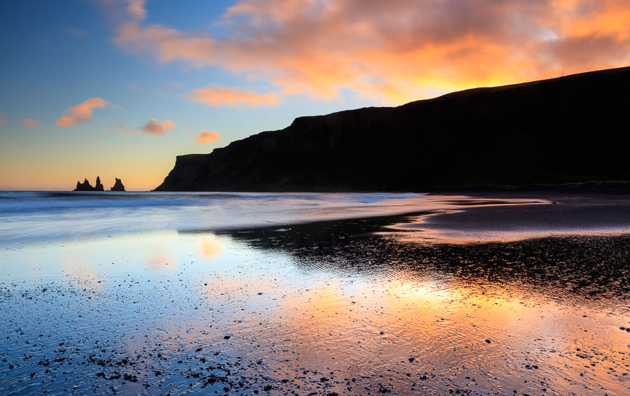 Sunset at Vik. Far back to the left are the stacks of hard to erode rocks that remains, when the loser parts have broken down into pebbles and sand.