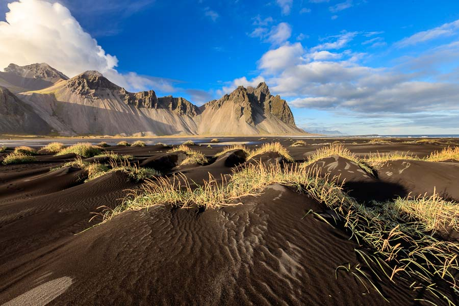 Stokksnes at evening sunlight. The sand is like most of Iceland of volcanic origin.