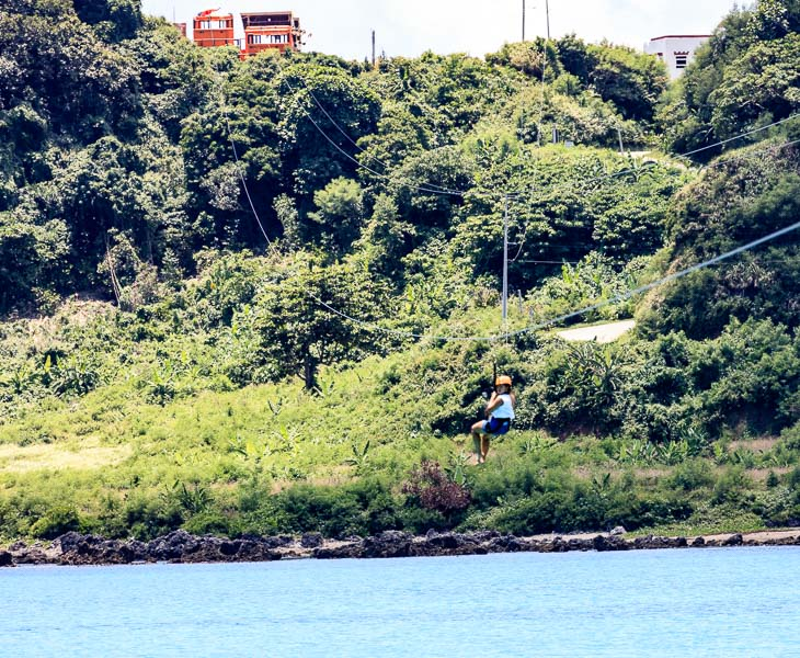 Mikee is ziplining in Pagudpud crossing the Blue Lagoon