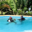The pool is very deep and built specially to teach scuba diving