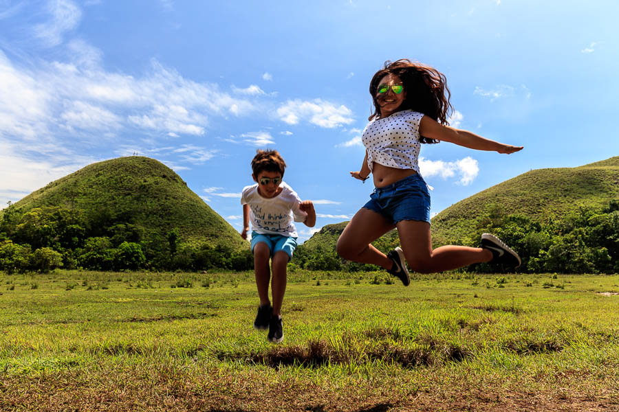 Another jump shot in front of the chocolate hills