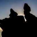 """At sunrise from the other side, """"Rugged Jack"""" is seen in silhouette."""