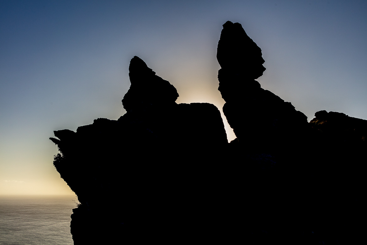 "At sunrise from the other side, ""Rugged Jack"" is seen in silhouette."
