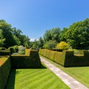 Walking up the entrance between the yew hedges protecting the formal gardens.