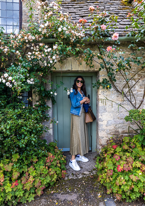 Jennifer showing the size of the doorway into one of the cottages.