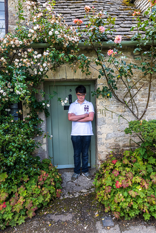 And a not entirely happy Eric posing in the same doorway